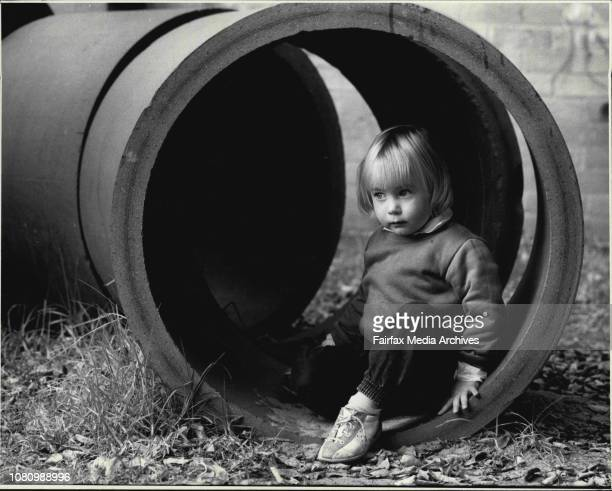 Contemplative Cath Thompson, aged two, at the Laurel Tree-House child-care centre in Glebe. June 15, 1987. .
