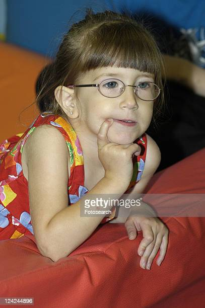 contemplative face of a little girl with disabilities, including a visual impairment. - cerebrum stock photos and pictures