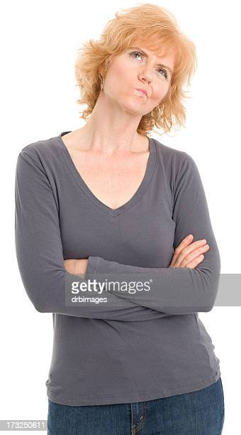 contemplative mature woman - gray shirt stock pictures, royalty-free photos & images