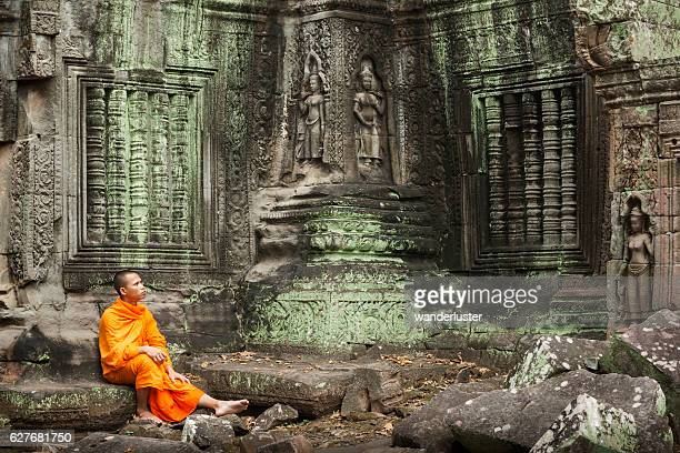 contemplative monk at ruins - angkor stock photos and pictures