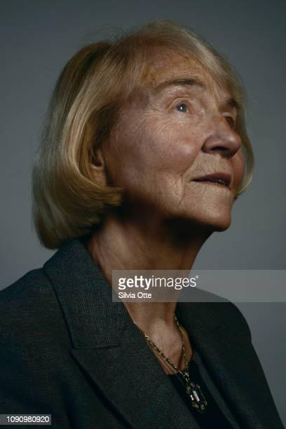 Contemplative senior business woman