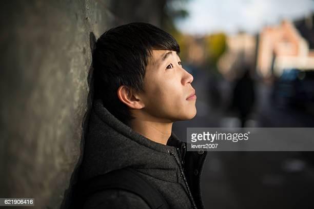 Contemplative young Japanese man