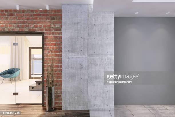 contemporary apartment interior with big grey wall - column stock pictures, royalty-free photos & images