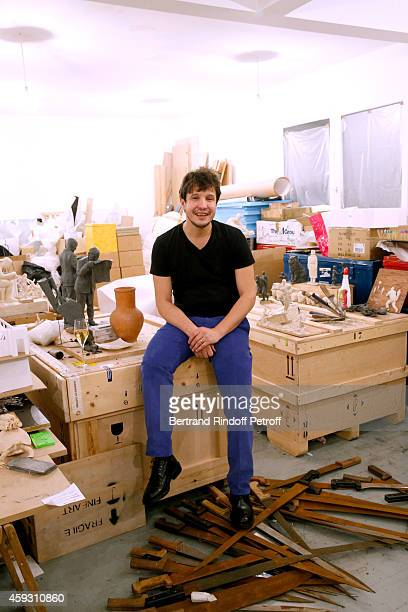 Contemporary artist Adel Abdessemed poses in his studio whyle Helene Cixous receives Insignia of Officer of the Legion of Honor at the Home of Adel...