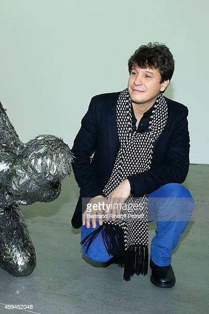 Contemporary artist Adel Abdessemed poses with his sculpture a selfportrait representation of his beheading by his father during a closing party and...