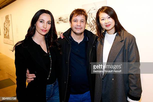 Contemporary artist Adel Abdessemed with his wife Julie and Lida Guan attend the 'Jean Nouvel and Claude Parent Musees a venir' Exhibition Opening at...
