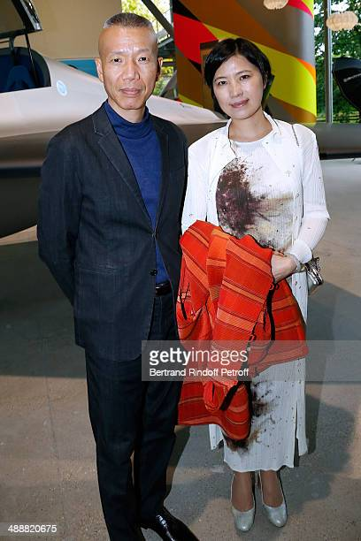 Contemporary artist GuoQiang Cai and his assistant attend the 'Fondation Cartier pour l'art contemporain' celebrates its 30th anniversary on May 8...