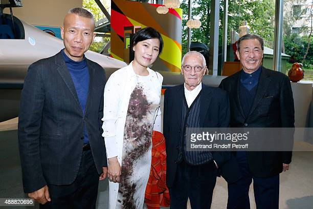Contemporary artist GuoQiang Cai his assistant contemporary artists Alessandro Mendini and Issey Miyake attend the 'Fondation Cartier pour l'art...