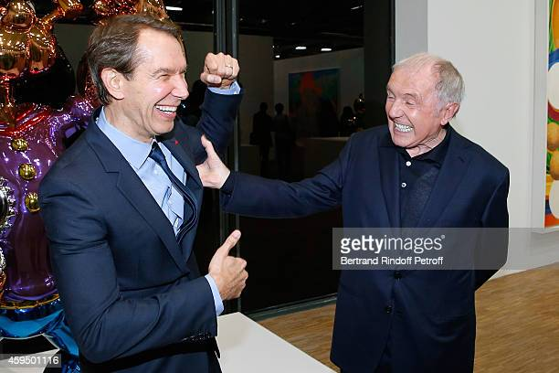 Contemporary Artist Jeff Koons and Francois Pinault attend the 'Jeff Koons' Retrospective Exhibition Private Visit at Beaubourg on November 23 2014...