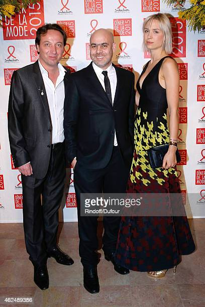 Contemporary Artist Laurent Grassot standing between Galerist Emmanuel Perrotin and his companion AnneSophie Mignaux attend the Sidaction Gala Dinner...