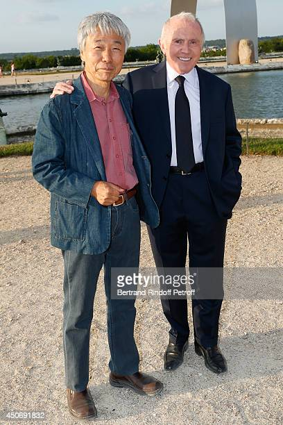 Contemporary Artist Lee Ufan and Francois Pinault attend the private tour and dinner of the Lee Ufan's Exhibition at Chateau de Versailles on June...