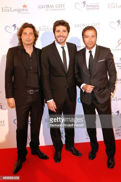 Contemporary Artist Oreliski singer Patrick Fiori and Bernard Montiel attend the 'Global Gift Gala' 2014 Charity Dinner at the Four Seasons Hotel on...
