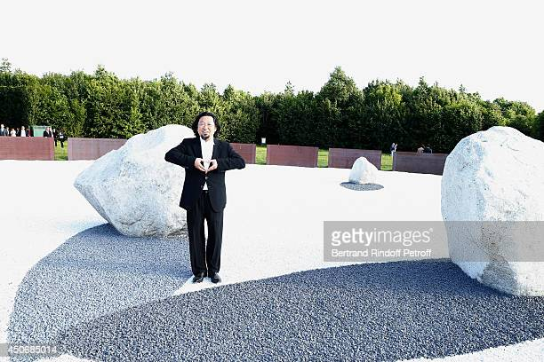 Contemporary artist Takashi Murakami posing in front of 'Relatum L'ombre des etoiles' attends the private tour and dinner of the Lee Ufan's...