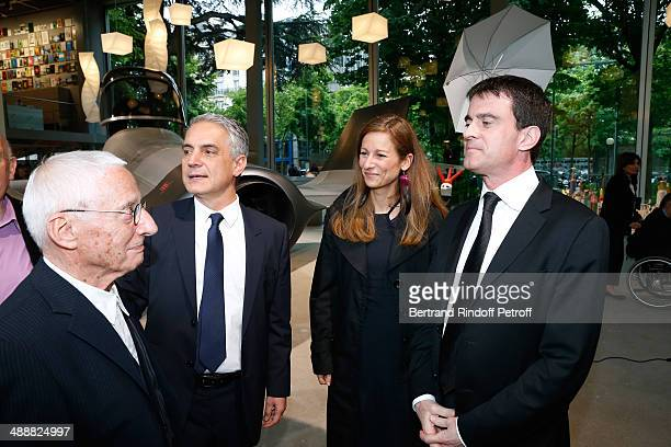 Contemporary artists Alessandro Mendini Director of 'Fondation Cartier' Herve Chandes French Prime Minister Manuel Valls and his wife violonist Anne...