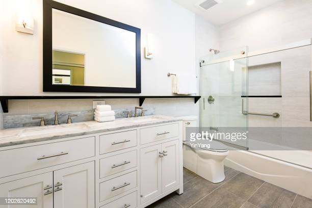 contemporary bathroom design with vanity and shower bathtub - vanity stock pictures, royalty-free photos & images