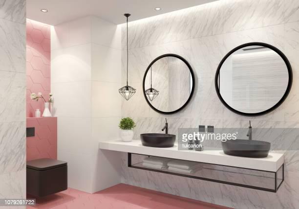 banheiro contemporâneo com telhas luz do favo de mel-de-rosa - chão de cerâmica - fotografias e filmes do acervo
