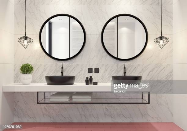 contemporary bathroom with light pink honeycomb tiles - mirror frame stock photos and pictures