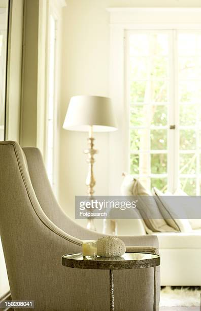 Contemporary chair in traditional living room