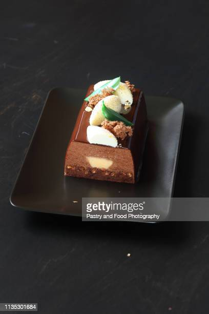contemporary chocolate mousse cake with lemon curd center - yule log stock pictures, royalty-free photos & images