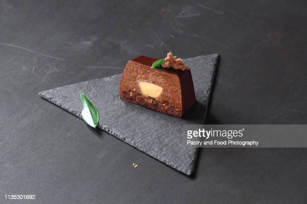 contemporary chocolate mousse cake with lemon curd center - part of stock pictures, royalty-free photos & images