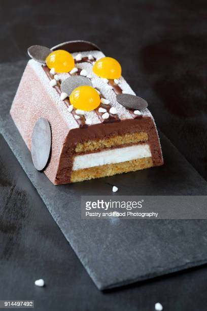 contemporary chocolate vegan mousse cake - yule log stock photos and pictures