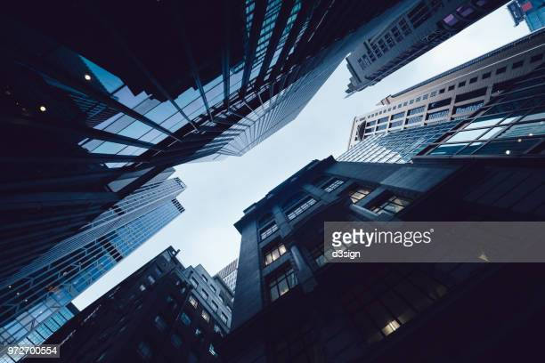 contemporary financial skyscrapers from ground view against sky - global finance stock pictures, royalty-free photos & images