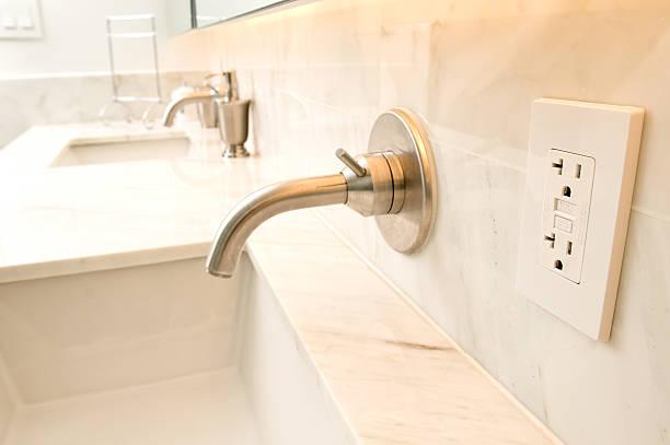 Contemporary fixtures in bathroom