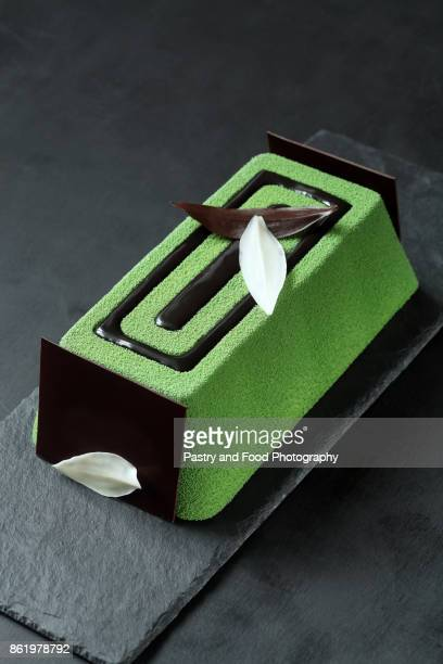 contemporary green tea mousse cake - yule log stock pictures, royalty-free photos & images