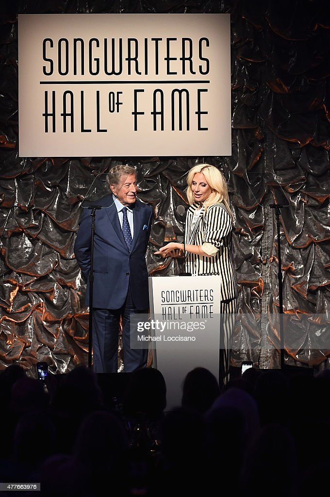 Contemporary Icon Award Recipient Lady Gaga and Singer Tony Bennett speak onstage at the Songwriters Hall Of Fame 46th Annual Induction And Awards at Marriott Marquis Hotel on June 18, 2015 in New York City.