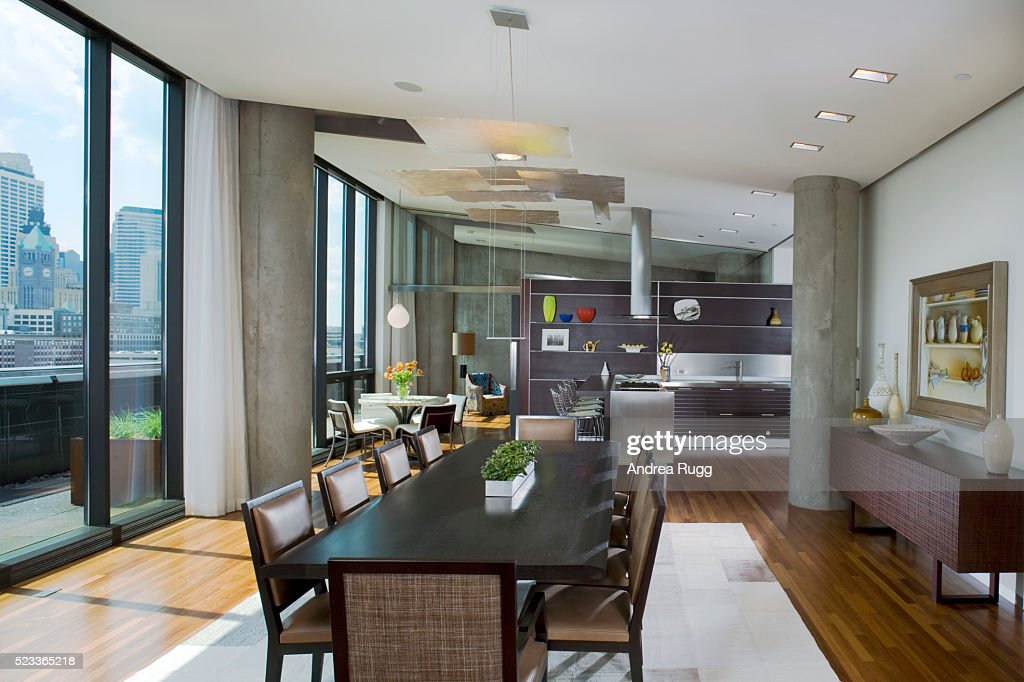 Contemporary Kitchen And Dining Room Adjacent To Terrace Stock Photo