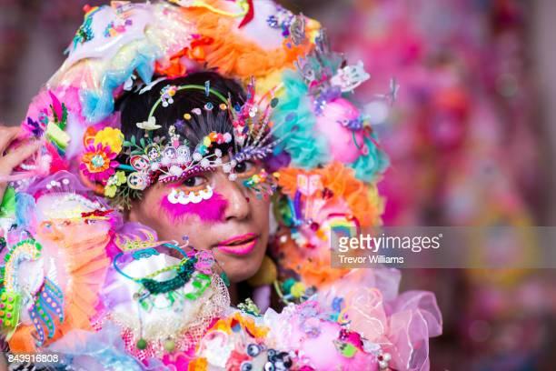 A contemporary performance artist wears textile art pieces
