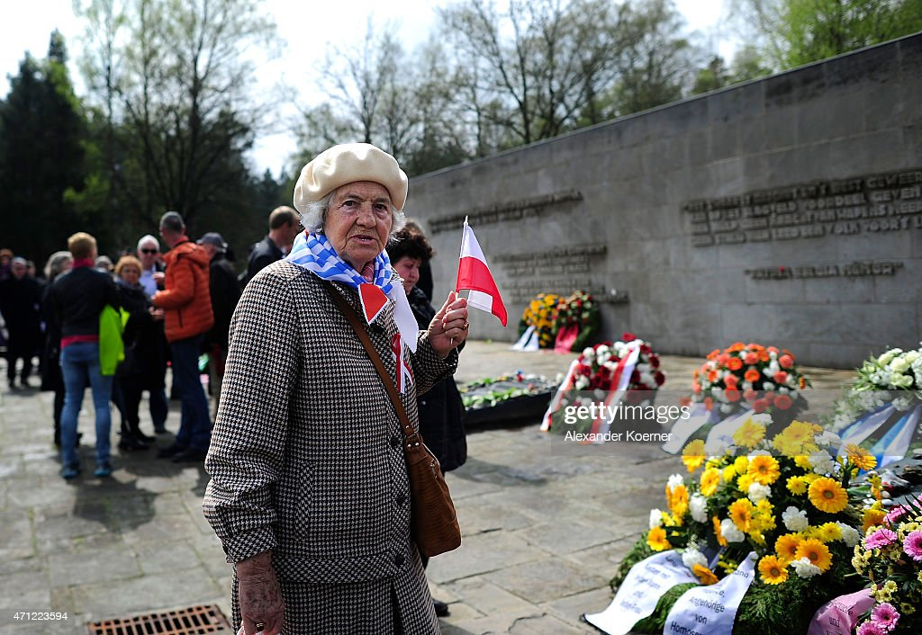A contemporary witness looks on in front of a memorial plaque during a ceremony to commemorate the 70th anniversary of the liberation of the Bergen-Belsen concentration camp at the former camp site on April 26, 2015 near Lohheide, Germany. An estimated 70,000 inmates died at the hands of the Nazis at Bergen-Belsen during World War II, including Jews and Soviet prisoners of war. Most famous among the victims is Anne Frank, who died at Bergen-Belsen of typhus shortly before the liberation by British troops in April, 1945.