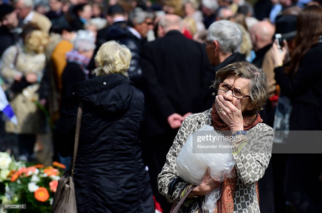 A contemporary witness reacts by a memorial plaque during a ceremony to commemorate the 70th anniversary of the liberation of the Bergen-Belsen concentration camp at the former camp site on April 26, 2015 near Lohheide, Germany. An estimated 70,000 inmates died at the hands of the Nazis at Bergen-Belsen during World War II, including Jews and Soviet prisoners of war. Most famous among the victims is Anne Frank, who died at Bergen-Belsen of typhus shortly before the liberation by British troops in April, 1945.