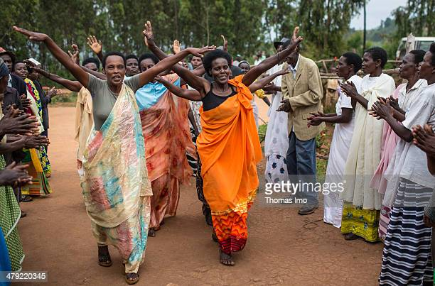 Contemporary witnesses of the Rwanda Genocide in 1994 singing and dancing at a therapeutic meeting on February 03 2014 in Nyakagezi Rwanda The...