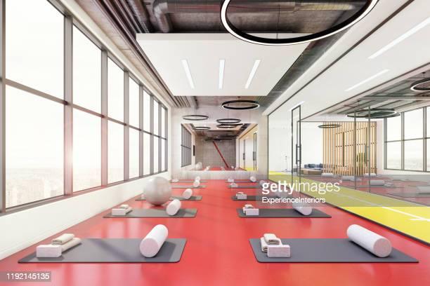 zeitgenössischeyoga-raum-interieur - yogastudio stock-fotos und bilder