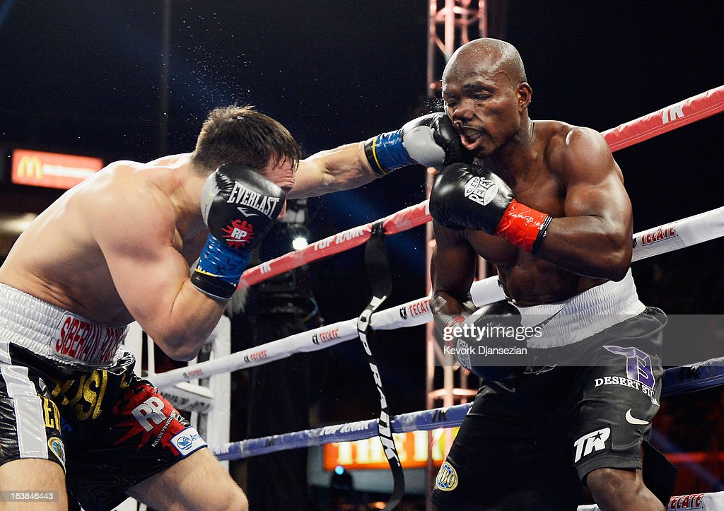 Contender Ruslan Provodnikov lands a punch to the head of WBO Welterweight Champion Timothy Bradley during their WBO Welterweight Championship boxing match at The Home Depot Center on March 16, 2013 in Carson, California.