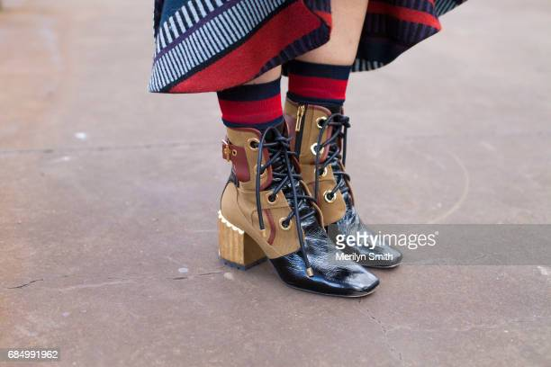 Content Creator Yvette Hardy wearing Dior boots Gucci socks and a Johanna Ortiz skirt during MercedesBenz Fashion Week Resort 18 Collections at...