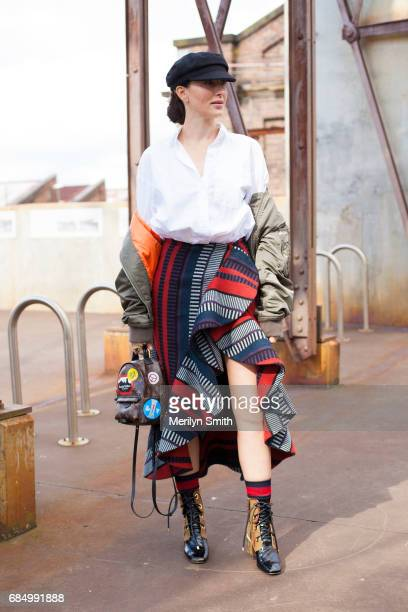 Content Creator Yvette Hardy wearing Dior boots Gucci socks Johanna Ortiz skirt Zara top Rag and Bone bomber jacket and a Isabel Marant hat during...