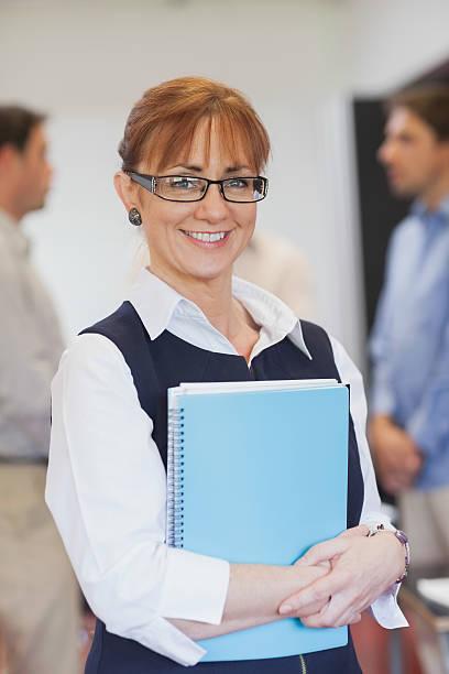 Content female mature student posing in classroom