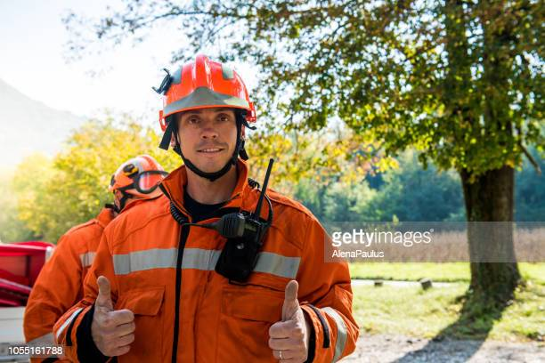 content firefighter portrait - firefighter stock pictures, royalty-free photos & images