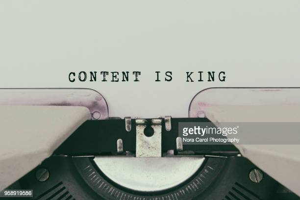 content is king text typed on vintage typewriter - contented emotion stock pictures, royalty-free photos & images