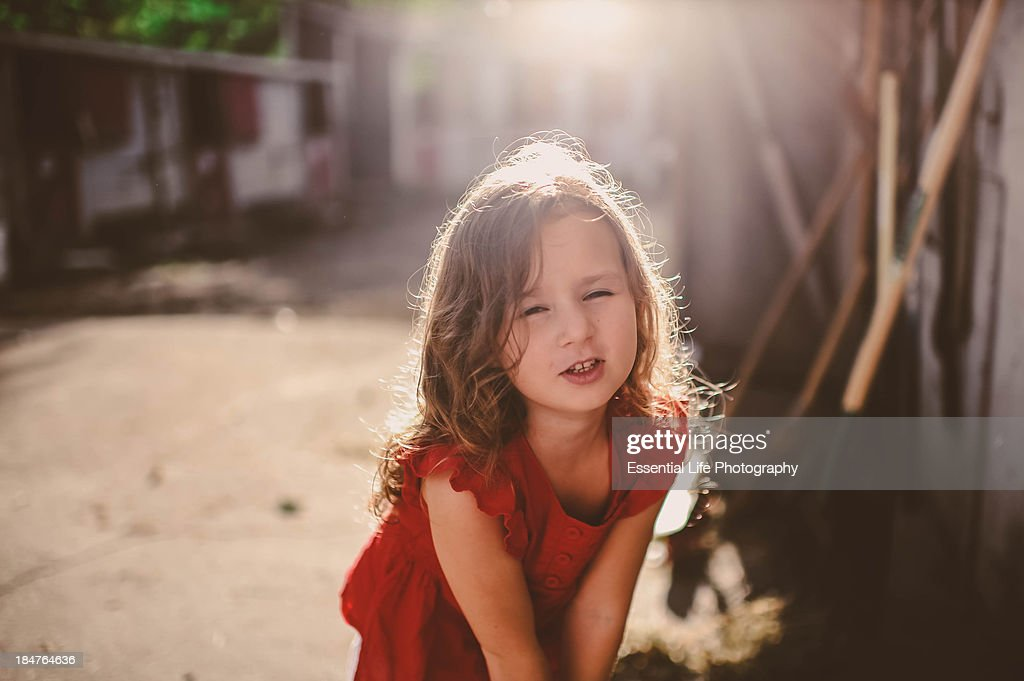 Content. Little girl, cute face at a farm. : Stock Photo