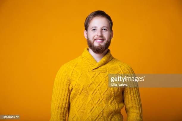 content model in bright sweater - knitted stock pictures, royalty-free photos & images