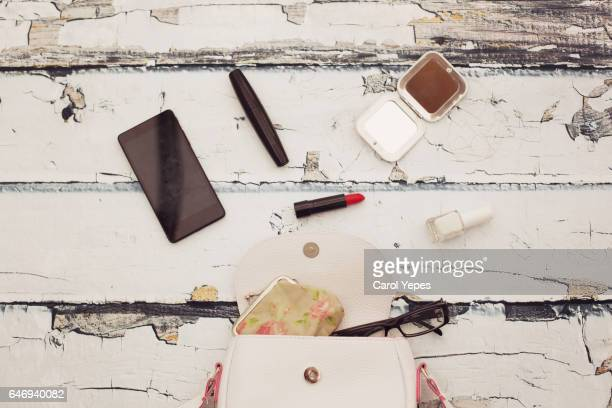 content of woman bag.Overhead shot