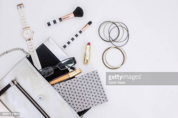 content of woman bag.overhead shot - clutch bag stock pictures, royalty-free photos & images