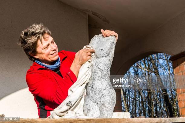 Content Woman Admiring Beautiful Stone Statue