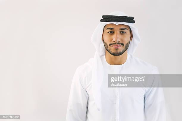 Content Young Arab Man in Traditional Clothing