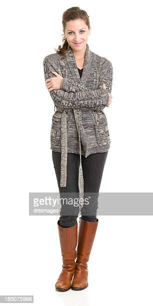 content young woman standing with arms crossed - gray coat stock pictures, royalty-free photos & images