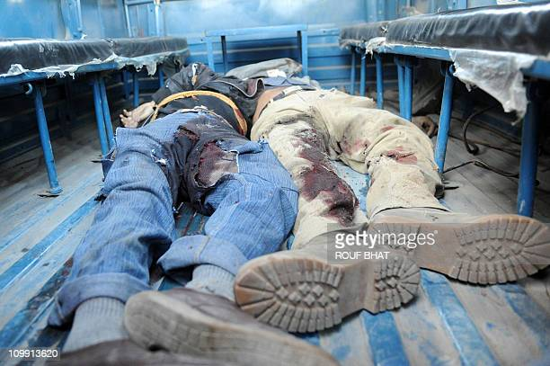 CONTENTBodies of two suspected militants shot dead lie inside a police vehicle after an exchange of gunfire in Srinagar on the banks of Dal Lake on...