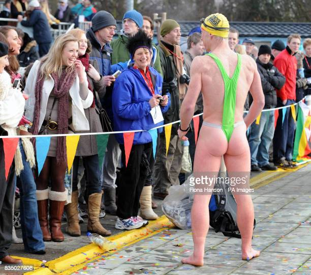 Charity swimmer Graham Smith braves the cold with humour and a mankini during the National Cold Water Swimming Championship at Tooting Bec London